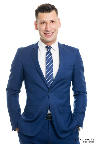 Melbourne Corporate Portrait of Real Estate Agent in Blue suit on a white background