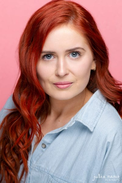 Melbourne actor headshot on woman with red hair on pink background