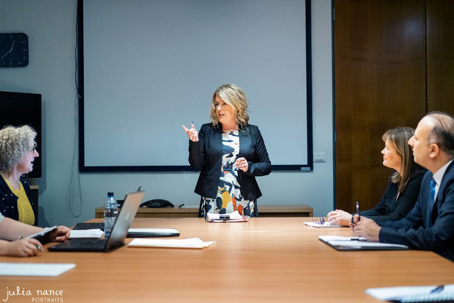 Melbourne branding photography on site of woman in board room meeting
