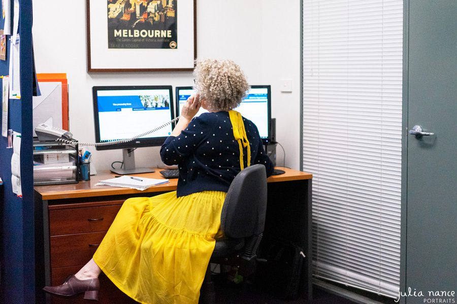 Melbourne personal branding photography of woman on telephone at desk