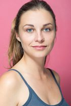 Girl with blue eyes on pink background for acting headshots