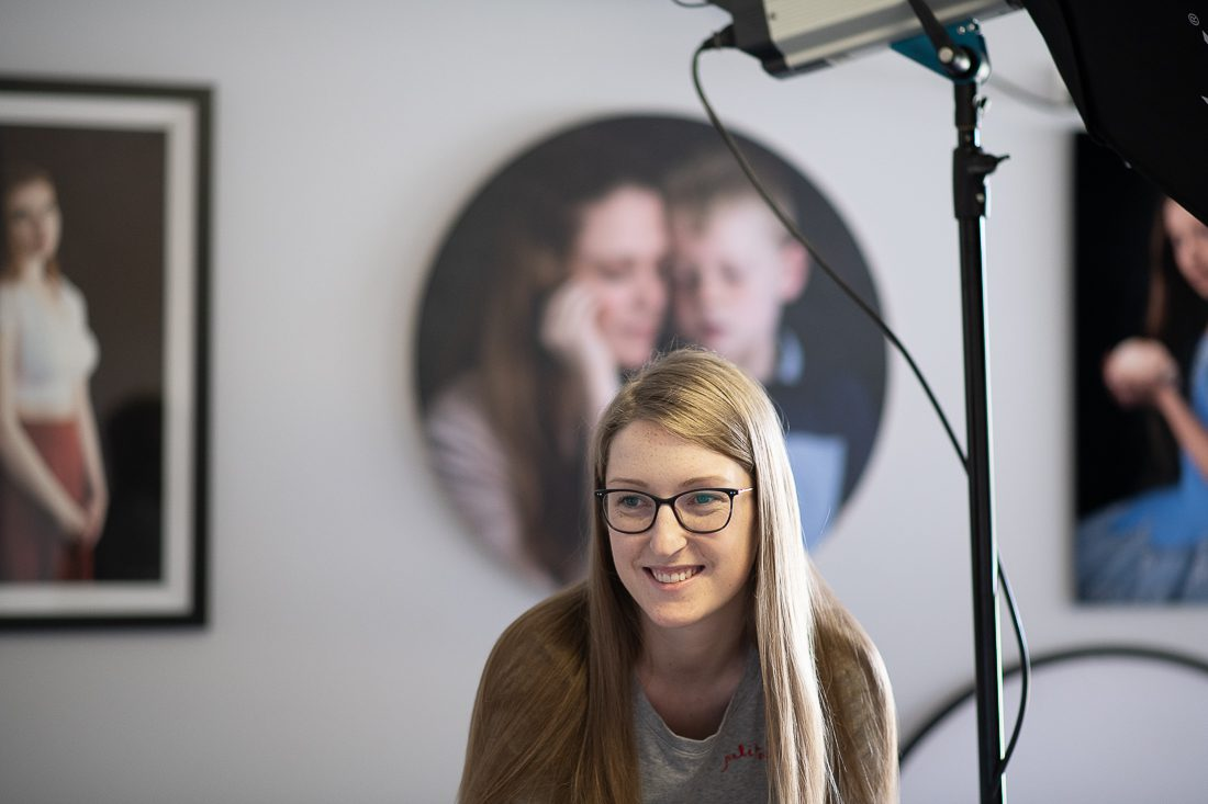 Julia Nance in her professional headshot photography studio, smiling