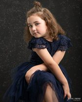 Young children's fashion portrait of girl in studio.